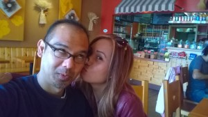 John Gamboa and his wife kiss at Suzette Crepe Cafe - Berkeley, CA