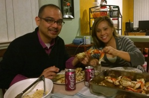 John Gamboa and his wife eating Roasted Garlic Crab at home