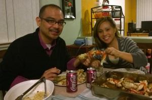 John Gamboa and his wife eating Roasted Garlic Crab at home